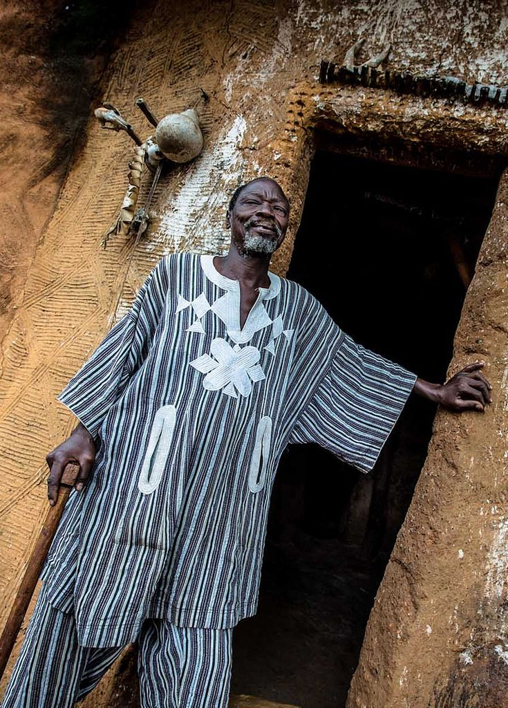 Africa | Somba man standing outside of his house (Tata Somba). Benin | ©Anthony Pappone