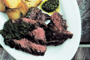 Chargrilled skirt steak with crisp potatoes and chimichurri