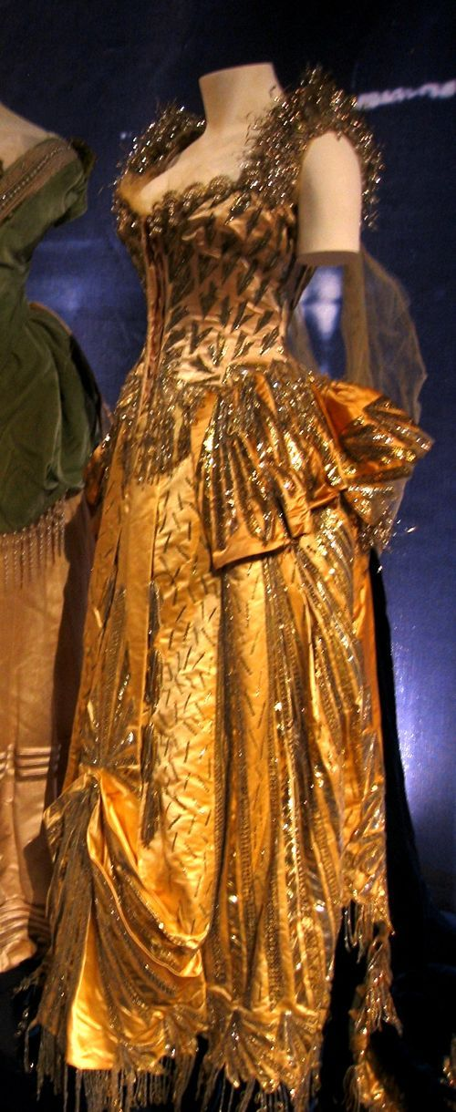 The Worth gown Alice Vanderbilt wore to Alva Vanderbilt's costume ball in 1883.  She was costumed as the 'Electric Light' and carried an electric torch above her head.