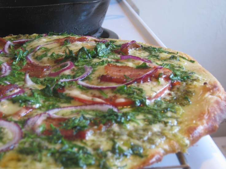 for this pesto pizza we put fresh slices of tomato and put a finely ...
