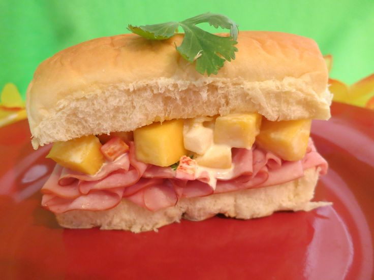 The salty ham and curried, spicy mango slaw are a perfect complement ...