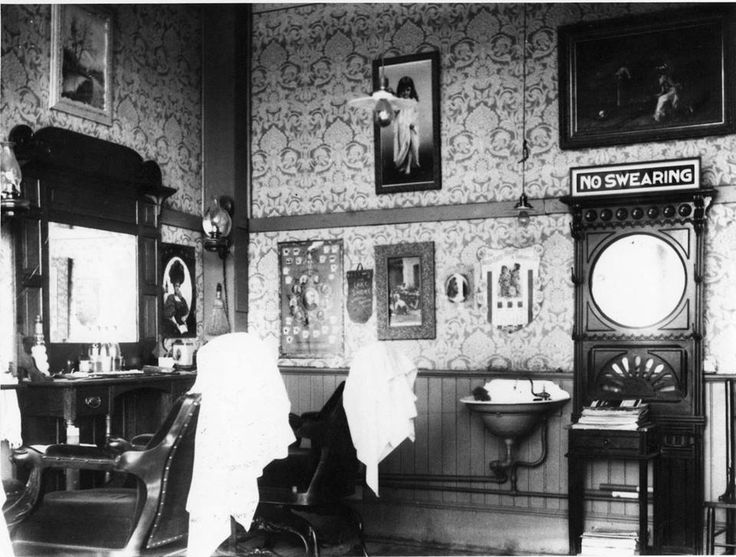 This is a photo of the inside of a Barber Shop around late 1800s or ...