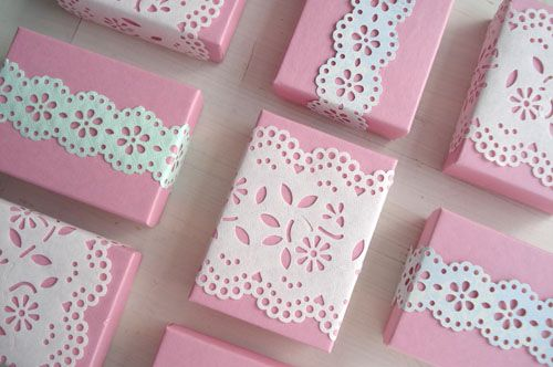 """doily lace"" punched paper on gift boxes"
