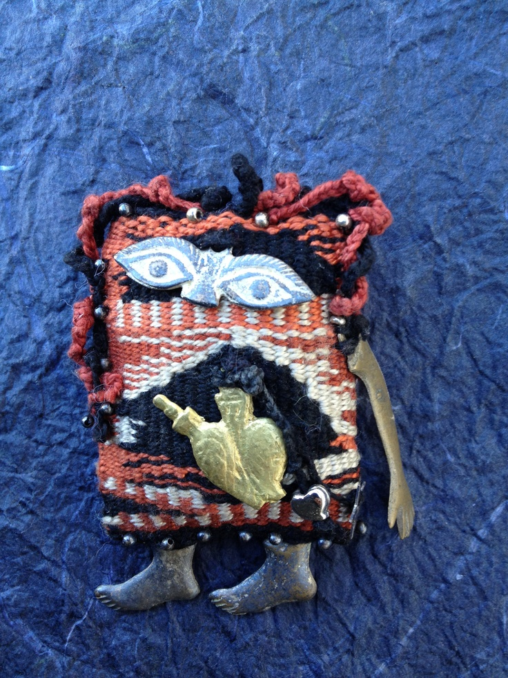 """""""Milagro Baby,"""" pin by Gail Gagnon Garcia, handwoven fabric, charms, silver beads. G3 was a Redlands, CA, artist who died about 9 years ago. Miss you, Gail."""