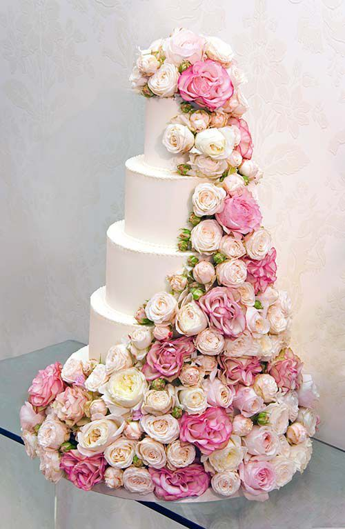Love the roses cascading down the five tiers of this wedding cake!! By Philippa Craddock.