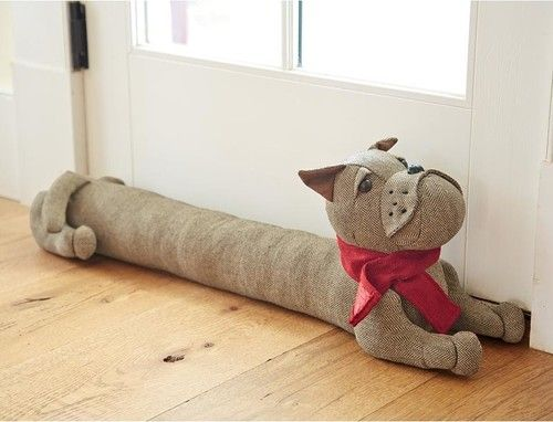 Cute door/draft stopper! $29.95 from Plow and Hearth.