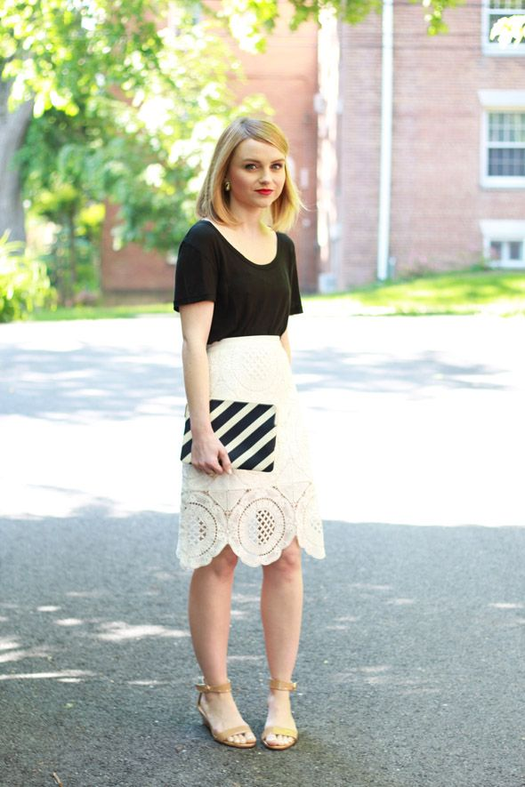Blogger Poor Little It Girl goes for a graphic look with a Gap striped clutch.
