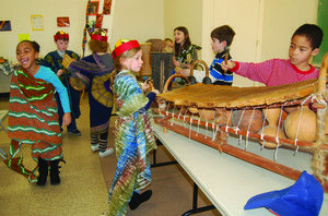 Students play with authentic African instruments and clothing during their Experience Africa field trip program.