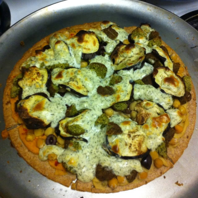 ... pizza with chickpeas, roasted eggplant, falafel, tzatziki, hummus