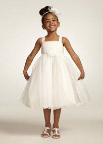 Adorable organzadress isutterly precious for the flower girl on your special day.  Ruched tank bodice is accented with3D flowers at waist.  Tea-length ball gown skirtfeatures ruffle trim for a look that is girly and fun.  Fully lined. Back zip. Dry clean only.  Blue Print and Pink Print available online only(). White and Ivory available in stores ().  Prints coordinate with bridal gown style Style T3267 and Style MK3433.
