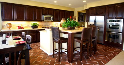 Love the warm colors of this kitchen I esp love the double oven and