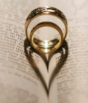 shaped wedding rings on bible wedding ideas