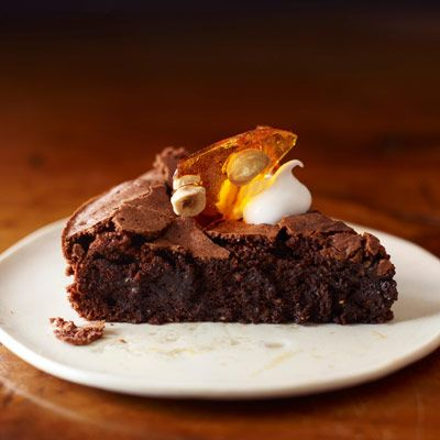 The truffle-like texture of this flourless chocolate hazelnut cake is ...