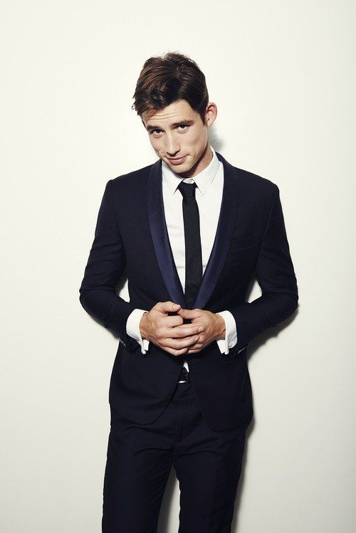 navy suit with black tie matricball