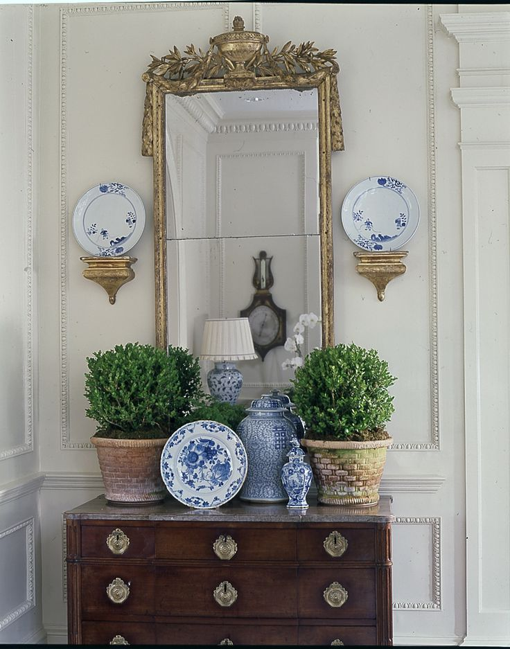 "Console table with gold gilt mirror; blue and white porcelain; topiaries. ""Perfect in a hallway or corner  ~ the large mirror and antique gold capture the light & reflect it."" ~ Epi"