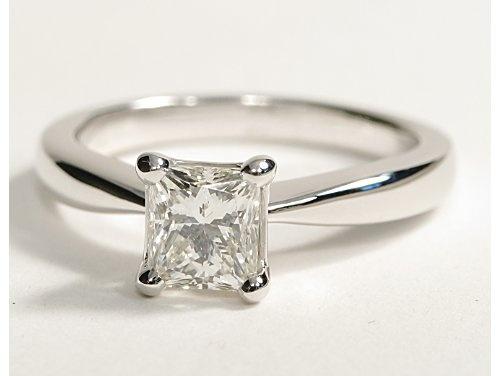 Princess cut 1.23 ct. Dream wedding ring. So simple. Love it.