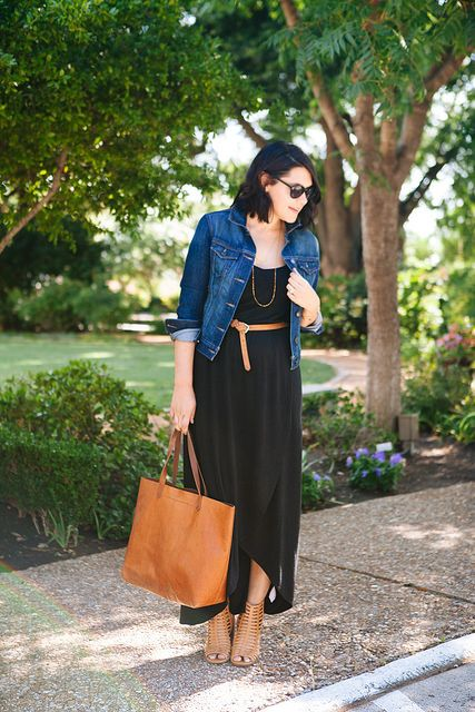 Black maxi, long gold necklack, tan bag and shoes, denim jacket
