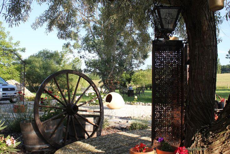 wagon wheel herb garden | La Mouillère Farmhouse Rental | Pinterest: http://pinterest.com/pin/337277459564574662/
