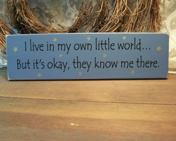 I live in my own little world Sign Wood Funny Painted Primitive. $11.00, via Etsy.