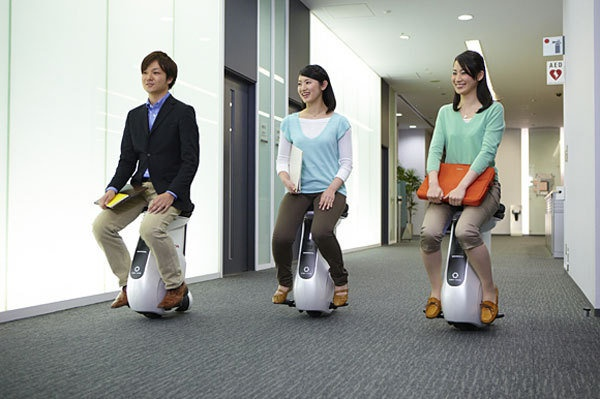 Honda's Uni-Cub, a rival for the Segway. But do people want to zip around their offices in a squat?