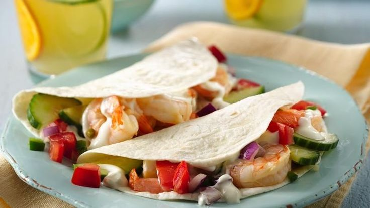 Tacos filled with warm citrus shrimp, fresh cucumber salsa and Greek ...
