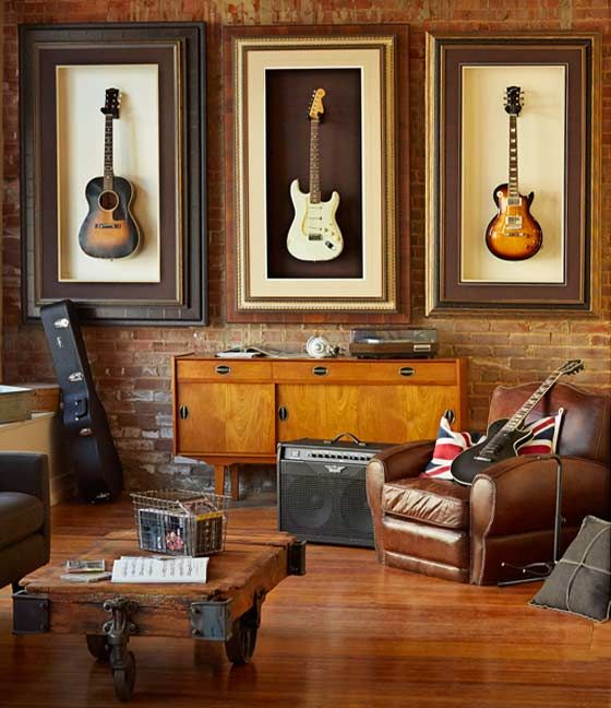 What a neat way to store your guitars while displaying them at the same time. Great music room decorating idea ♫