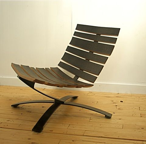 Uhuru Lounge Chair: Super-cool chair from Uhuru Designs.  The slats are made from reclaimed bourbon barrel staves.
