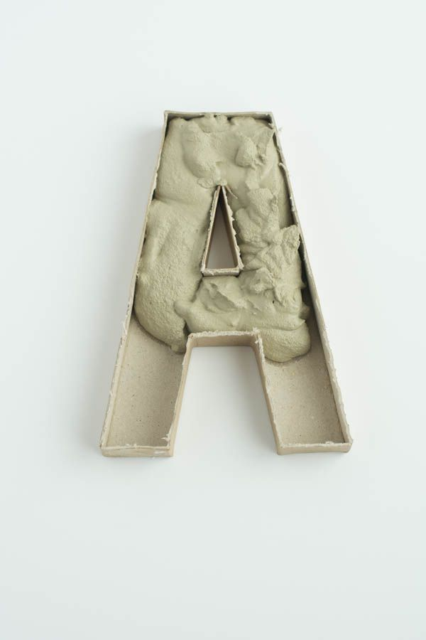 DIY: Gold Leaf Cement Paperweights. Easy to make! Letters, shapes, whatever you like.