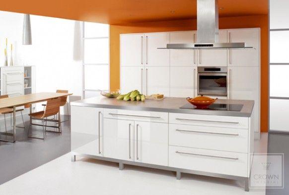 Kitchen orange walls and white cabinets kitchens for Orange kitchen walls