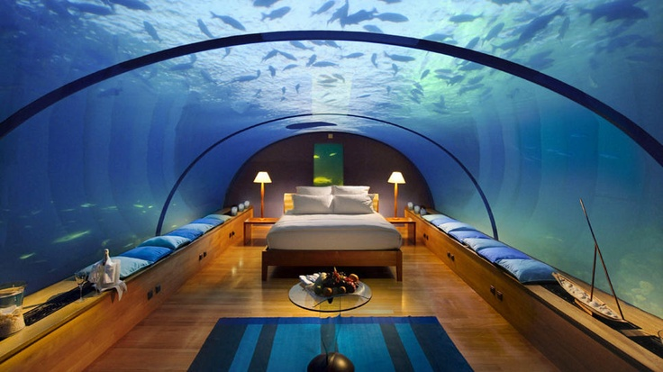 Rangali Island in the Maldives. Conrad Maldives Hotel has this awesome underwater suite and an undersea restaurant.