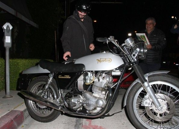 Keanu Reeves is spotted hopping onto his motorcycle and riding off in