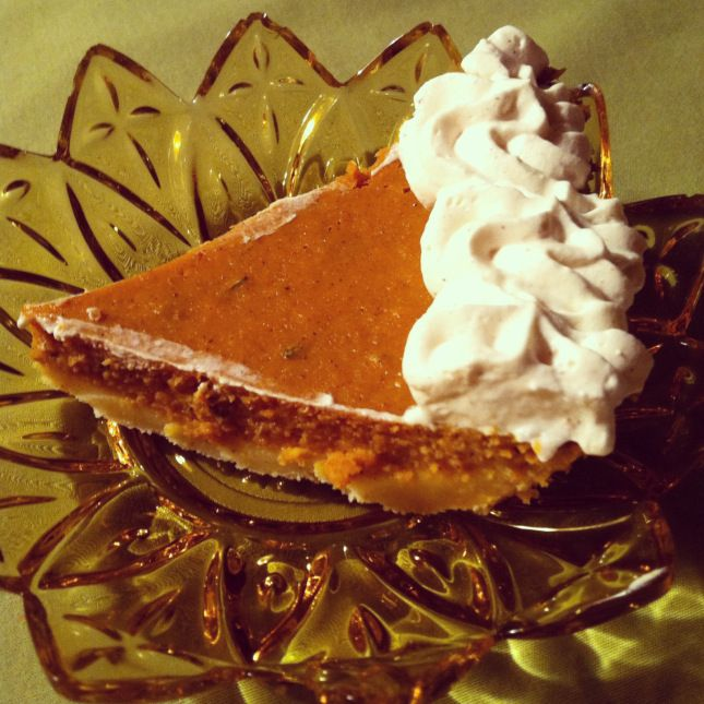 slice of pumpkin rosemary pie with cinnamon whipped cream.