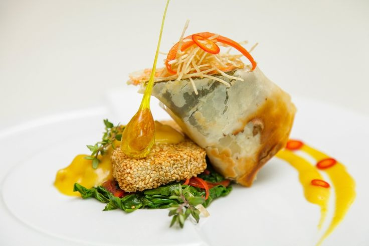 Oven-baked rolled salmon with crispy sesame tofu and spicy coconut ...