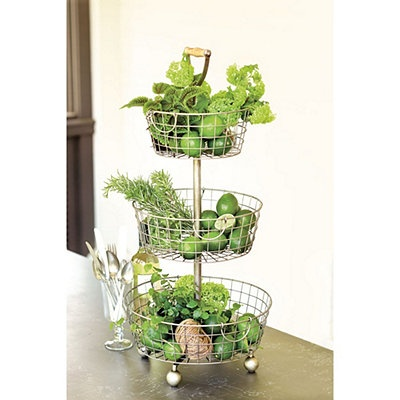 Put produce out on display with a tiered wire basket