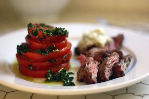 strip steak with blue cheese butter marinated heirloom tomatoes and ...