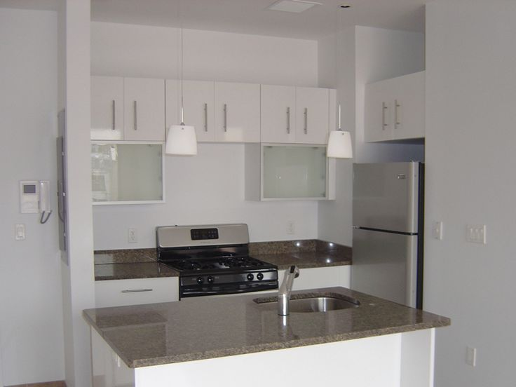 The Brooklyn Kitchen Cabinet Trend For White Continues With This