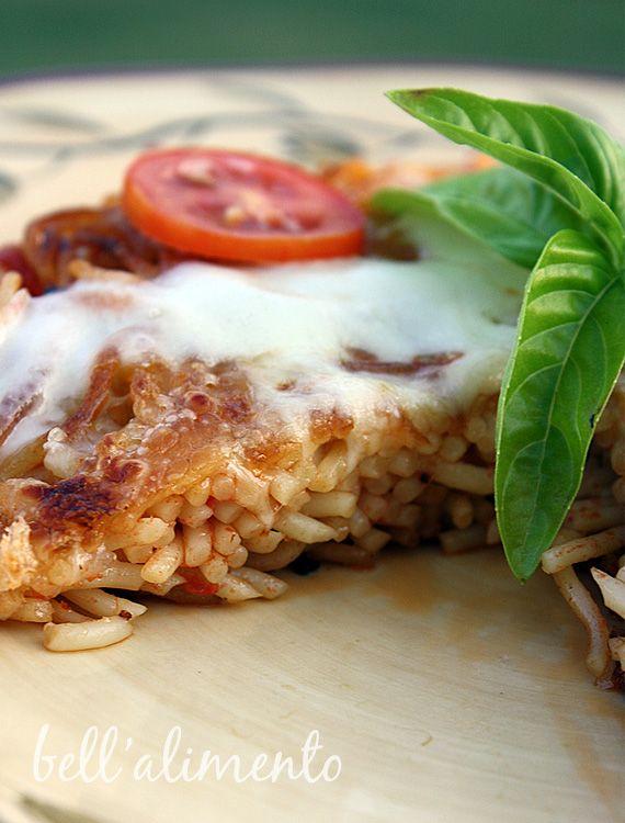 Spaghetti Pie .. They call it Spaghetti Pizza .. whichever you call it ...