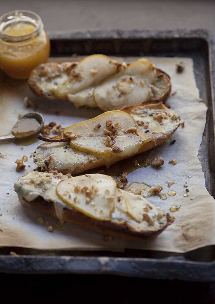 Very delicious pear and blue cheese tartines with honey and walnuts on ...