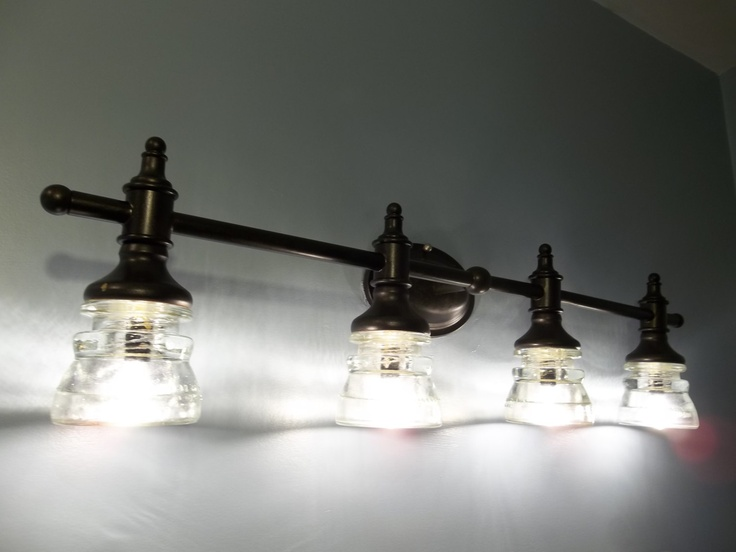 Vanity Lights With Clear Glass : Beautiful Clear Glass Insulator Vanity Light With Bronze Finish
