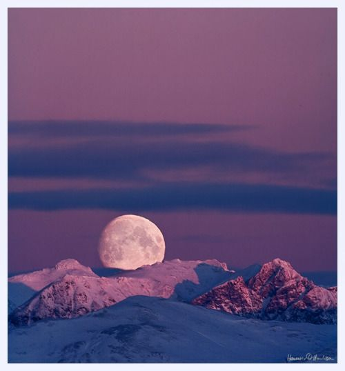 The moon just touched the peaks of mount Skarðsheiði that had just been hit by the first light of the day