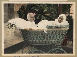 babies in vintage pram