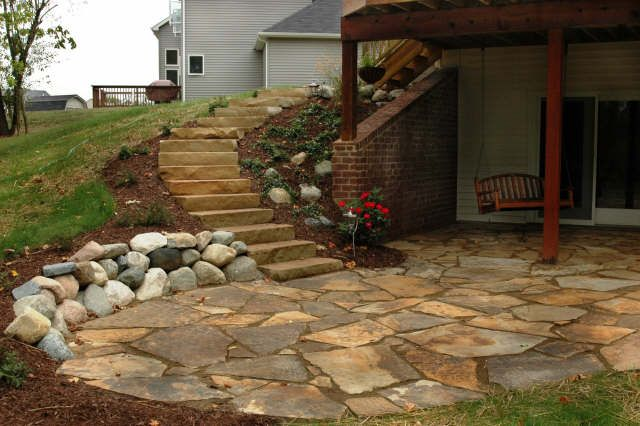 Flagstone patio rock garden french inspired kitchen - Natural stone patio designs ...