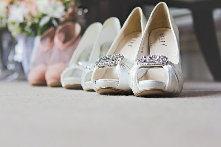 A detail photograph of the bride's and bridesmaids wedding shoes