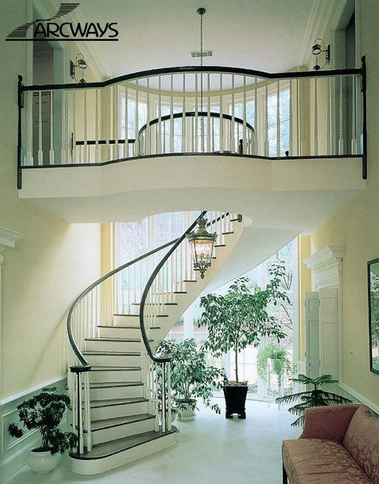 Elegant floating curved staircase staircases foyers for Curved staircase
