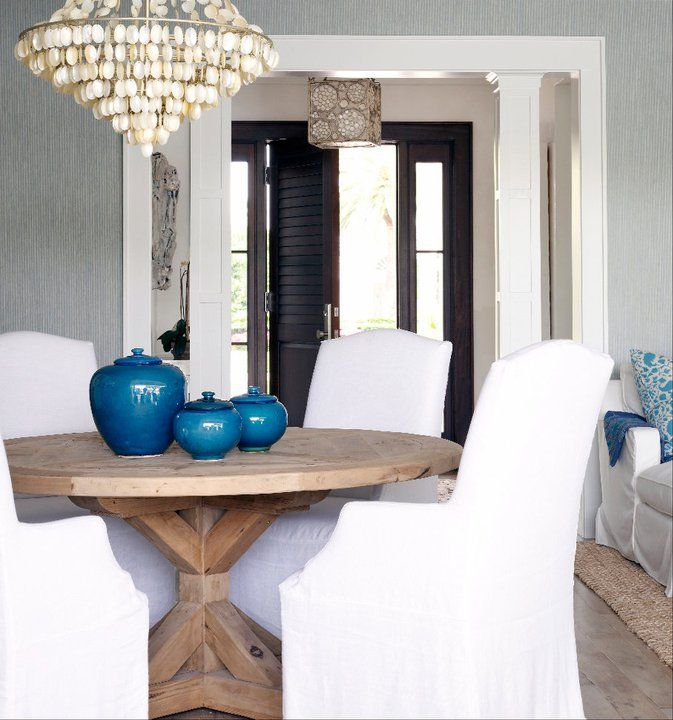 reclaimed wood table with fabric chairs