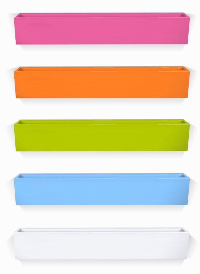Jennifer Delonge Bookshelf - love the bright pop of color for a child's room!