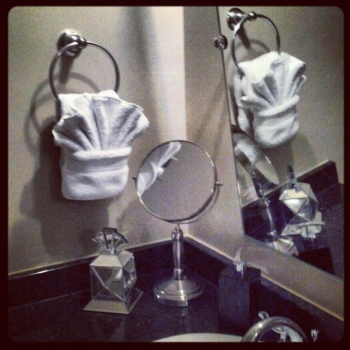Unique towel folding for my non existent guest bath what else could i do with these folds - How to display towels in bathroom ...