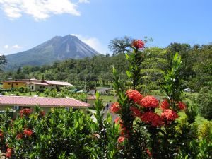 ...view the Arenal Volcano from a cabin in Costa Rica