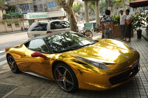 Photo taken on July 10 shows a gold colored Ferrari 458 Italia parked on a street in Shanghai.AFPpic