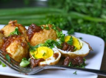 ... -fried hard boiled eggs topped with a sweet and sour tamarind sauce